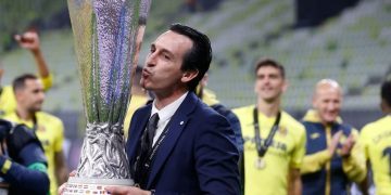 Villarreal's Spanish coach Unai Emery kisses the trophy after his team won the UEFA Europa League final football match between Villarreal CF and Manchester United at the Gdansk Stadium in Gdansk on May 26, 2021. (Photo by KACPER PEMPEL / POOL / AFP) (Photo by KACPER PEMPEL/POOL/AFP via Getty Images)